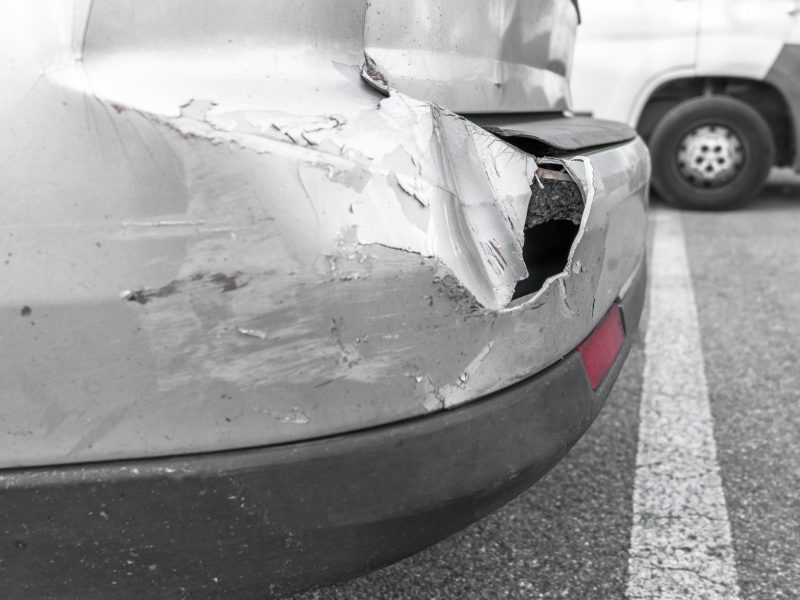 Back of gray car get damaged from accident on the road